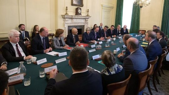Britain's Prime Minister Theresa May (C) hosts a roundtable meeting about housing supply at 10 Downing Street in central London on October 17, 2017.  / AFP PHOTO / POOL / Steve Parsons        (Photo credit should read STEVE PARSONS/AFP/Getty Images)